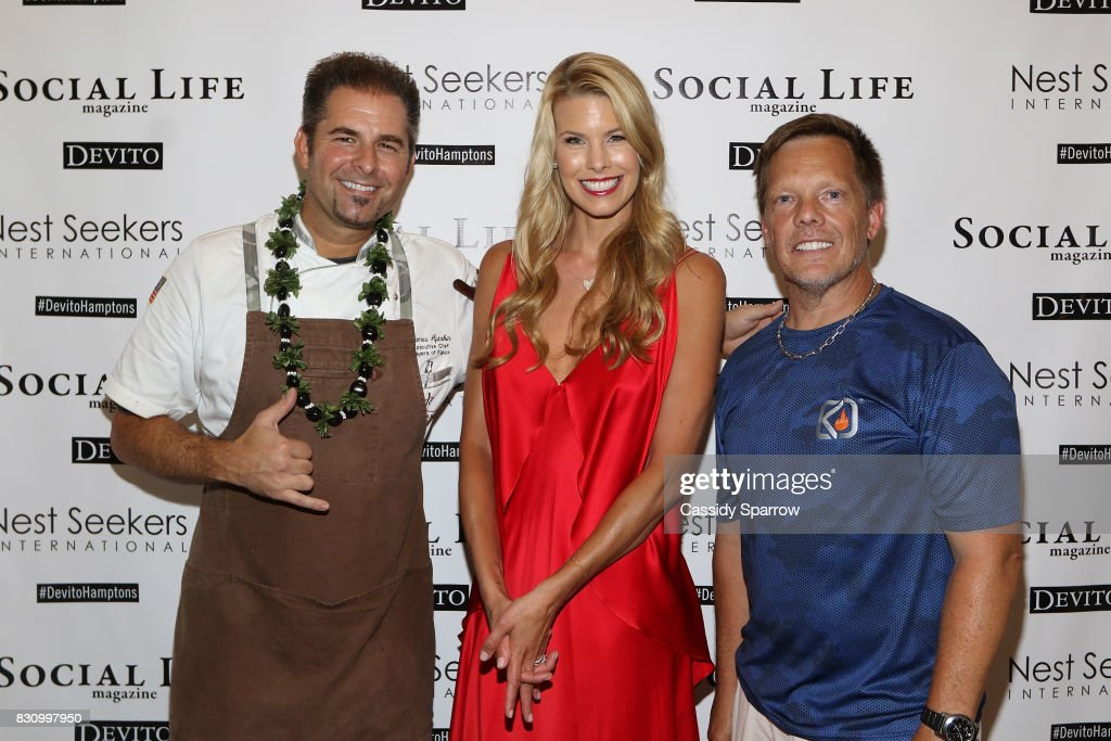 James Aptakin, Beth Stern and Michael Gotowala attend the Social Life Magazine Nest Seekers August Issue Party on August 12, 2017 in Southampton, New York.