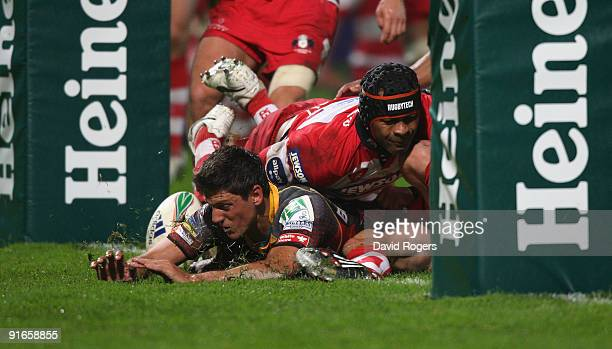 James Arlidge of Newport dives over to score their first try during the Heineken Cup match between Gloucester and Newport Gwent Dragons at Kingsholm...