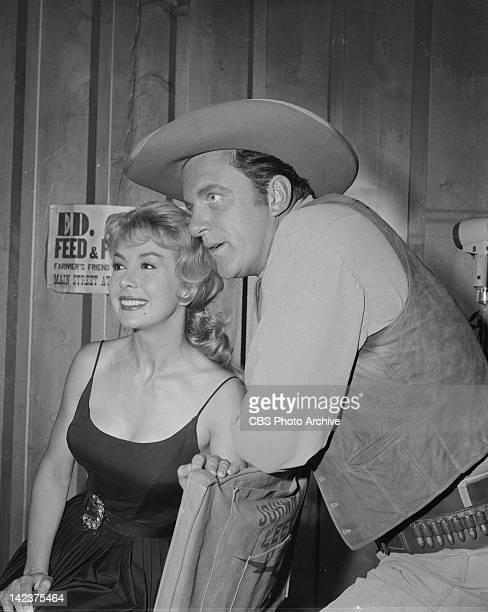 James Arness as Marshal Matt Dillon and Susan Cummings as Stella in the GUNSMOKE episode 'Peace Officer' Image dated June 22 1960