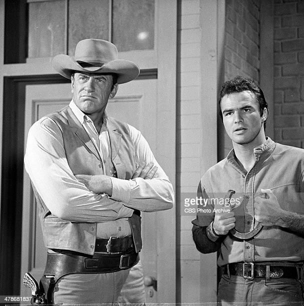 James Arness as Matt Dillon and Burt Reynolds plays Quint Asper during the GUNSMOKE opening Image dated July 31 1964
