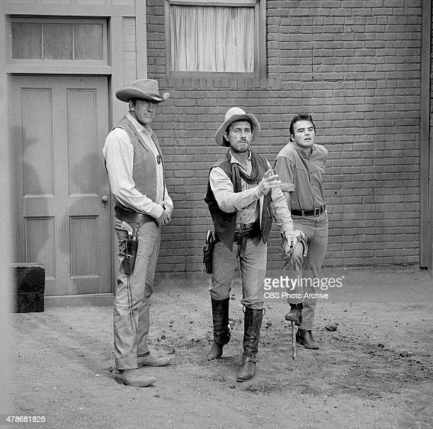 James Arness as Matt Dillon Ken Curtis as Festus Haggen and Burt Reynolds as Quint in the GUNSMOKE episode 'Circus Trick' Image dated June 8 1964