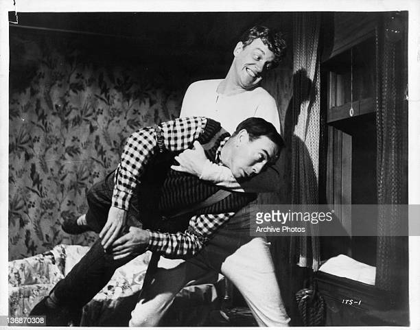 James Arness throws Lloyd Nolan out of a window in a scene from the film 'Island In The Sky' 1953