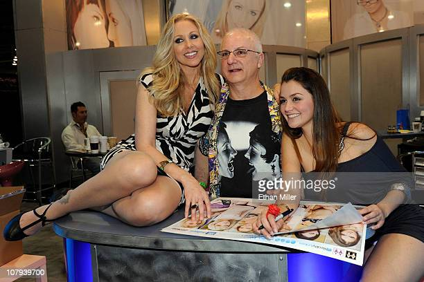 James Arnold of California poses for a photo between adult film actresses Julia Ann and Allie Haze at the 2011 AVN Adult Entertainment Expo at the...