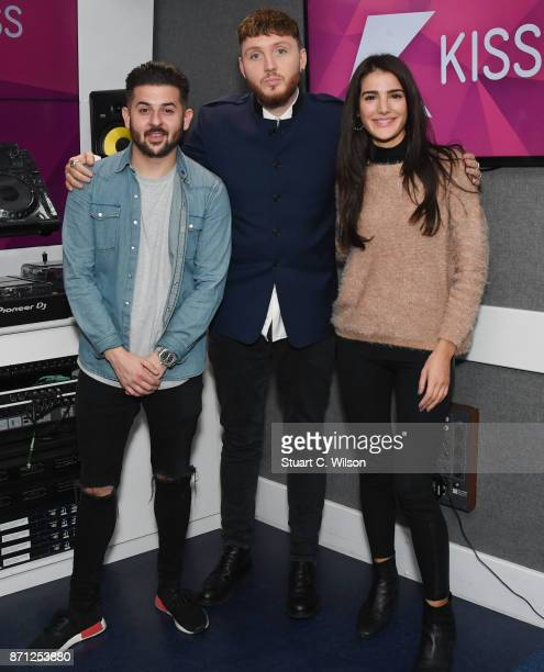 James Arthur poses with Alex Mansuroglu and Andrea Zara during a visit to Kiss FM Studio's on November 7 2017 in London England