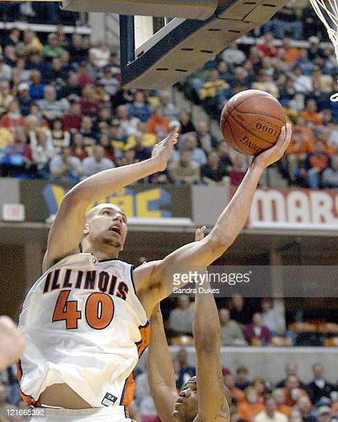 James Augustine drives for 2 points in the second half during the 2004 Big Ten Men's Basketball Tournament - llinois vs Indiana at Conseco...