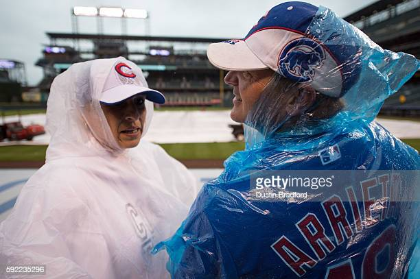 James Bailey of Chicago and Alexandra Skinner of Germany look over the field during a rain delay before a game between the Colorado Rockies and the...