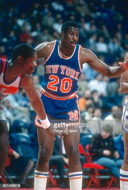 James Bailey of the New York Knicks looks to get position over Rick Mahorn of the Washington Bullets during an NBA basketball game circa 1985 at the...