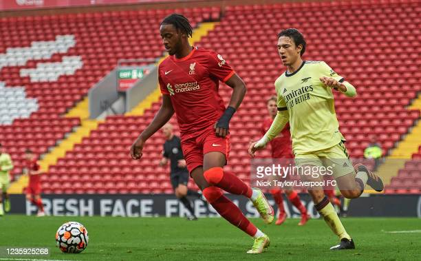 James Balagizi of Liverpool and Joel Lopez of Arsenal in action during the PL2 game at Anfield on October 16, 2021 in Liverpool, England.