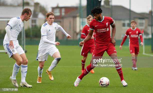 James Balagizi of Liverpool and Max Dean of Leeds United in action at Melwood Training Ground on November 21, 2020 in Liverpool, England.