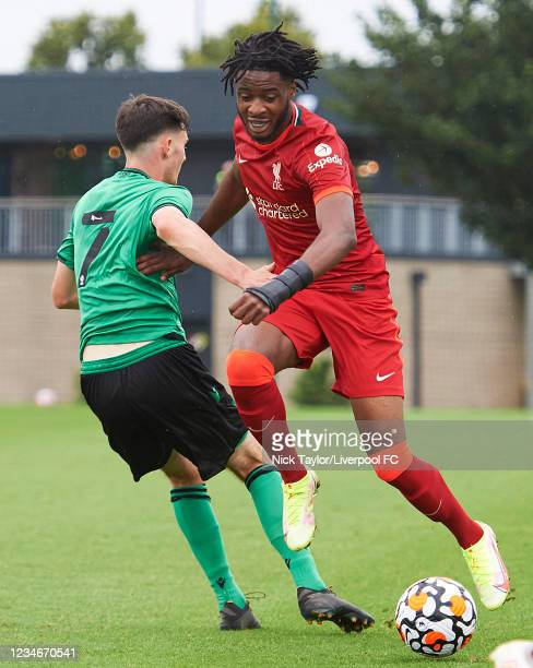 James Balagizi of Liverpool and Sam Knowles of Stoke City in action during the U18 Premier League game at AXA Training Centre on August 14, 2021 in...