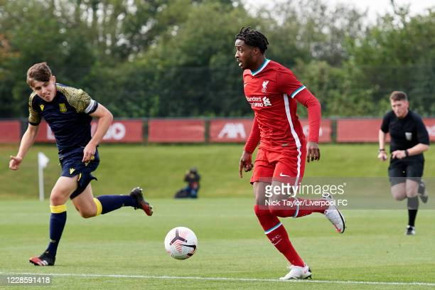 James Balagizi of Liverpool and Tom Sparrow of Stoke City in action during the U18 Premier League game at The Kirkby Academy on September 19 2020 in...