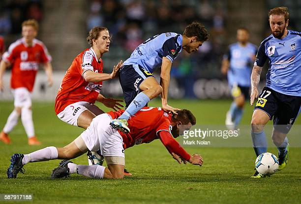 James Baldacchino of the Wolves and George Blackwood of Sydney FC contest possession during the FFA Cup round of 32 match between the Wollongong...