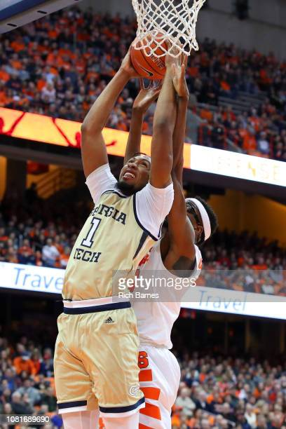 James Banks III of the Georgia Tech Yellow Jackets shoots the ball in front of Paschal Chukwu of the Syracuse Orange during the first half at the...