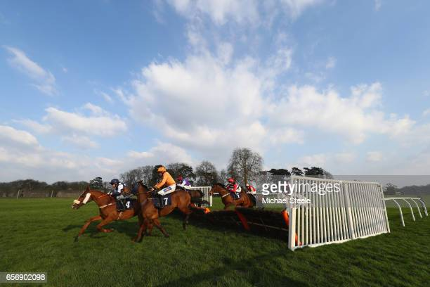 James Banks riding Orthodox Lad leads from Dave Crosse riding Karl Marx during the Recticel Handicap Hurdle race at Chepstow Racecourse on March 23...