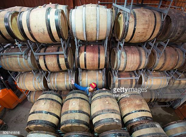 James Bardgett checks barrels that contain beer that has been brewed at the Wild Beer Co brewery at Lower Westcombe Farm on February 11 2016 near...