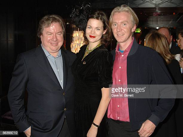 James Barratt Jasmine Guinness and Philip Treacy attend the Woodhead Caliva Christmas Party at Mortons Club on December 9 2005 in London