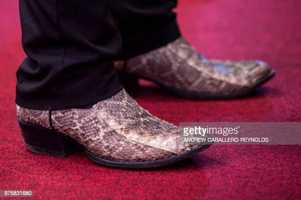James Bass wears snake skin boots during a Pentecostal serpent handlers service at the House of the Lord Jesus church in Squire West Virginia on May...