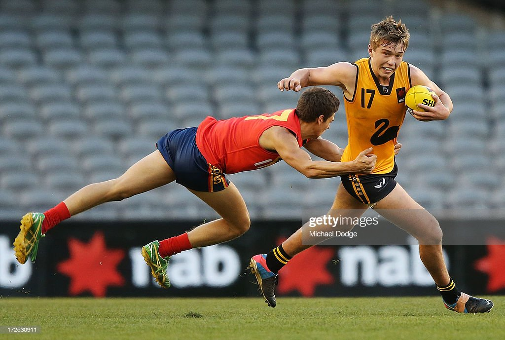 James Battersby of South Australia tackles Patrick Cripps of Western Australia during the AFL Under 18s Championship match between South Australia and Western Australia at Etihad Stadium on July 3, 2013 in Melbourne, Australia.