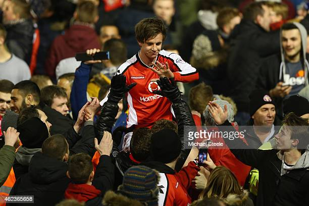 James Baxendale of Walsall is carried off the pitch on a supporters shoulders after his side reach the final after an aggregate 2-0 victory during...