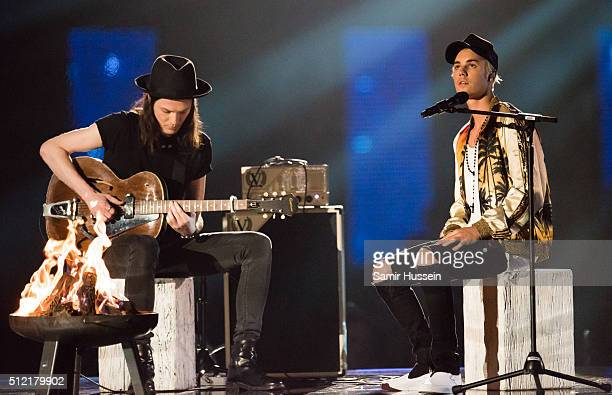 James Bay and Justin Bieber perform live on stage the BRIT Awards 2016 at The O2 Arena on February 24 2016 in London England