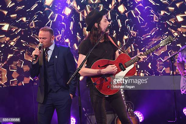 James Bay performs with Wayne Rooney during the England Footballers Foundation charity event at Sopwell House on May 29 2016 in St Albans England