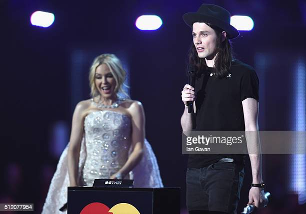James Bay with his Best British Male Solo Artist award on stage with award presenter Kylie Minogue at the BRIT Awards 2016 at The O2 Arena on...