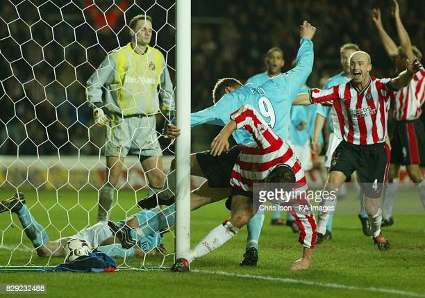 James Beattie and Chris Marsden of Southampton celebrate as Jo Tessem bundles his winning goal into the Sunderland net with the last touch of the...