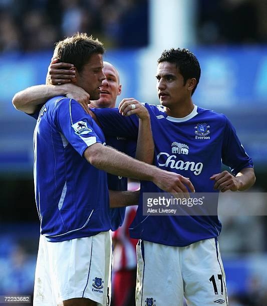 James Beattie of Everton celebrates scoring his team's second goal with team mates Andy Johnson and Tim Cahill during the Barclays Premiership match...