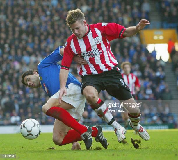 James Beattie of Southampton challenges Dejan Stefanovic of Portsmouth during the FA Barclaycard Premiership match between Portsmouth and Southampton...