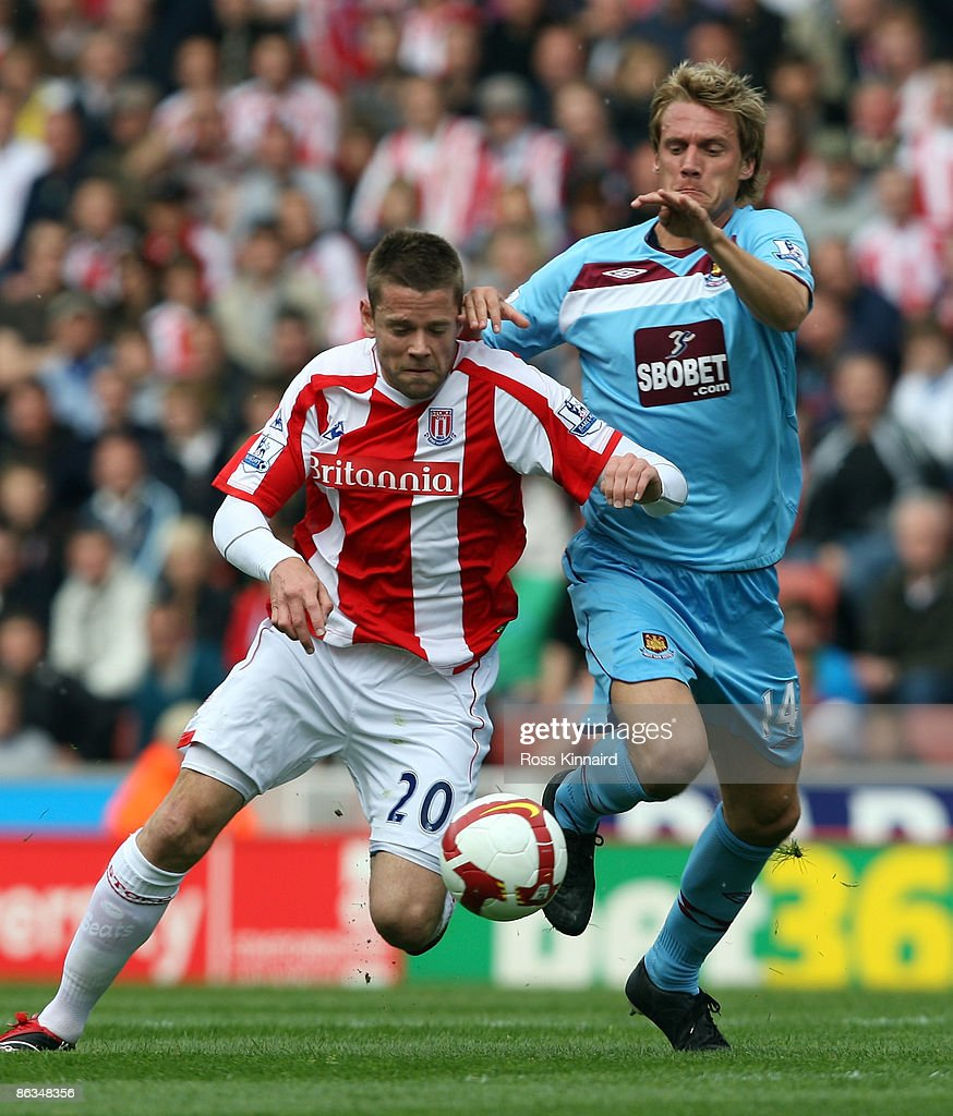 James Beattie of Stoke is challenged by Radoslav Kovac of West Ham during the Barclays Premier League match between Stoke City and West Ham United at the Britannia Stadium on May 2, 2009 in Stoke, England.