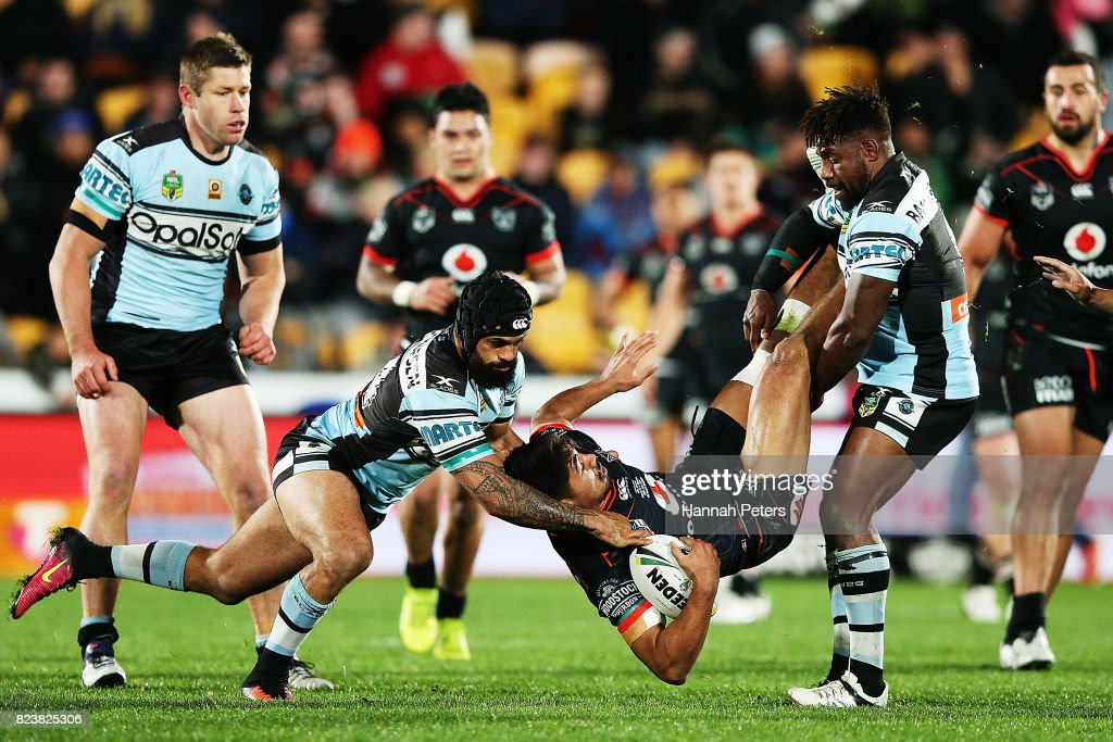 James Bell of the Warriors is lifted in the tackle during the round 21 NRL match between the New Zealand Warriors and the Cronulla Sharks at Mt Smart Stadium on July 28, 2017 in Auckland, New Zealand.