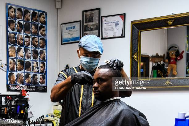 James Bennett speaks as he gets a haircut and free counselling by Antonio Wiggins at a barber shop in Jackson, Mississippi on September 26, 2020. -...