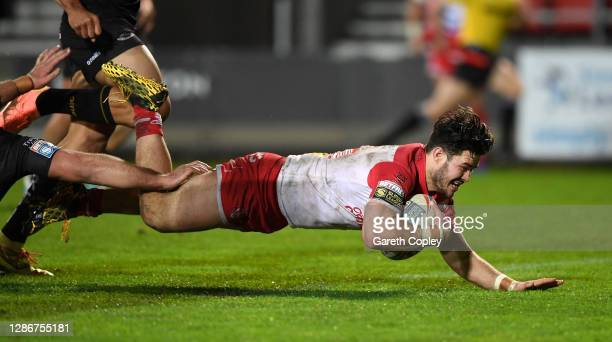 James Bentley of St He;ens scores a second half try during the Betfred Super League Play-Off Semi-Final between St Helens and Catalans Dragons at...