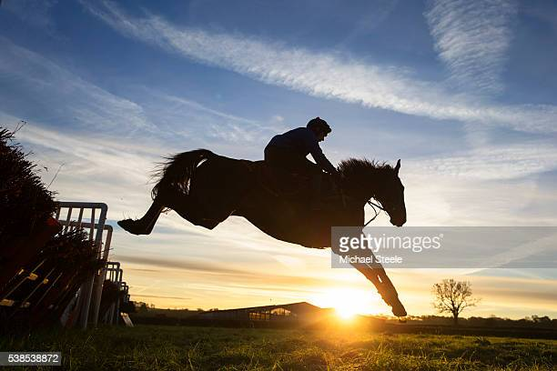 James Best riding Cloud Creeper during a schooling session on the lower ground at Sandhill Racing Stables on November 23 2015 in Minehead England...