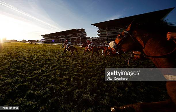 James Best riding So Fine win The Citipost Handicap Hurdle Race as the sun begins to set at Cheltenham racecourse on December 11, 2015 in Cheltenham,...