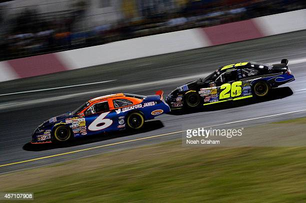James Bickford driver of the Sunrise Ford/Interstate Plastics/Lucas Oil Ford drives past Greg Pursley driver of the GPM/Star Nursery/Real Water Ford...