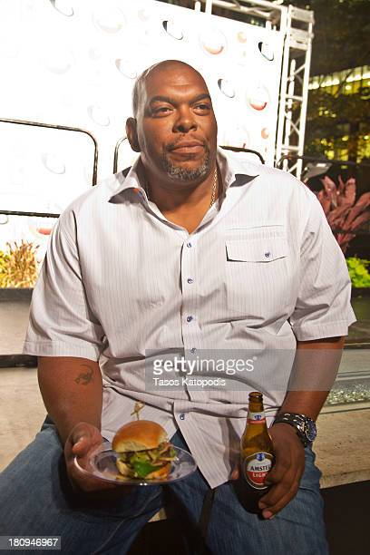 James 'Big Cat' Williams enjoys an 'Official Beer Of The Burger' at RedEye and Metromix's Battle of the Burger presented by Amstel Light at Howells...