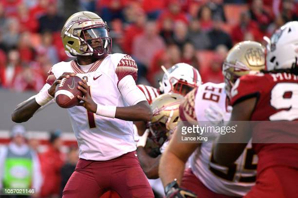 James Blackman of the Florida State Seminoles drops back to pass against the North Carolina State Wolfpack at CarterFinley Stadium on November 3 2018...