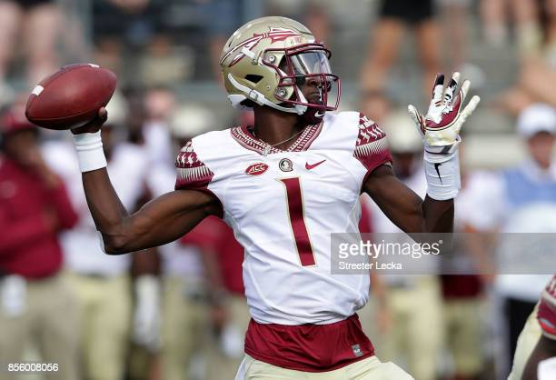 James Blackman of the Florida State Seminoles drops back to pass against the Wake Forest Demon Deacons during their game at BBT Field on September 30...
