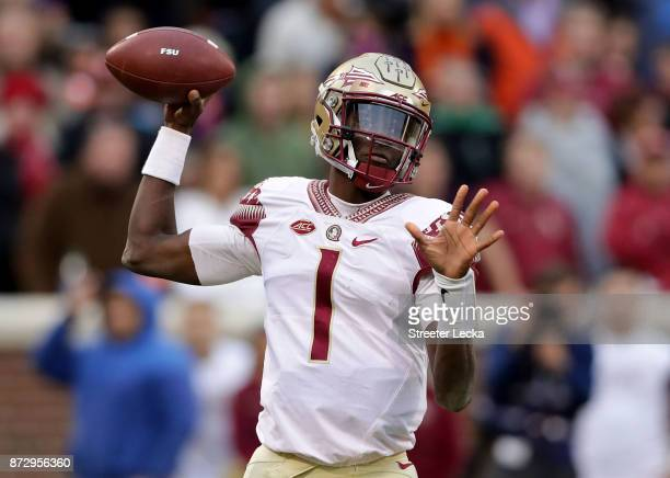 James Blackman of the Florida State Seminoles drops back to pass against the Clemson Tigers during their game at Memorial Stadium on November 11 2017...