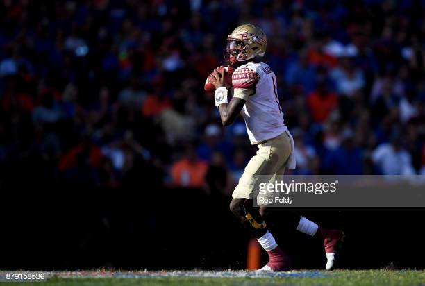 James Blackman of the Florida State Seminoles looks to pass during the game against the Florida Gators at Ben Hill Griffin Stadium on November 25...