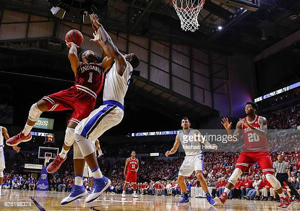 James Blackmon Jr #1 of the Indiana Hoosiers goes up for a shot against Xzavier Taylor of the Fort Wayne Mastodons at Memorial Coliseum on November...