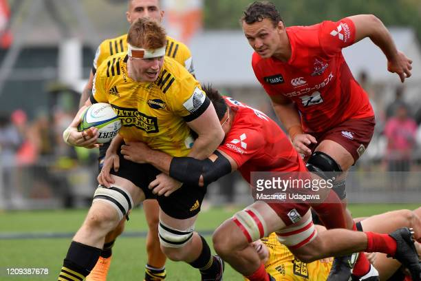 James Blackwell of the Hurricanes is tackled by Mitch Jacobson of the Sunwolves during the round five Super Rugby match between the Hurricanes and...