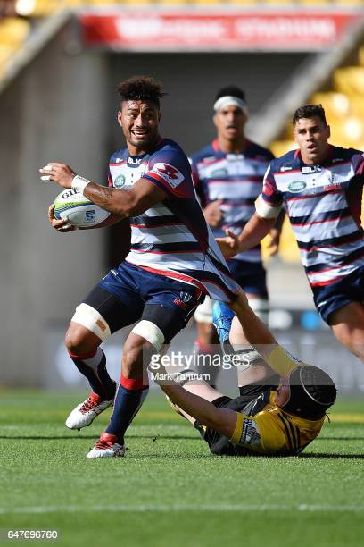 James Blackwell of the Hurricanes tackles Amanaki Mafi of the Melbourne Rebels during the round two Super Rugby match between the Hurricanes and the...