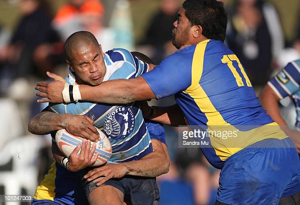 James Blackwell of the Leopards is tackled by Clendon Pene of the Hornets during the Fox Memorial Championship match between the Otahuhu Leopards and...