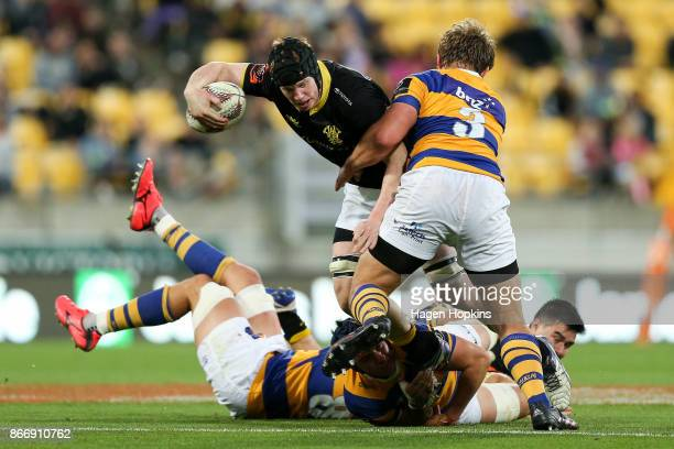 James Blackwell of Wellington is tackled by Jeff Thwaites of Bay of Plenty during the Mitre 10 Cup Championship Final match between Wellington and...