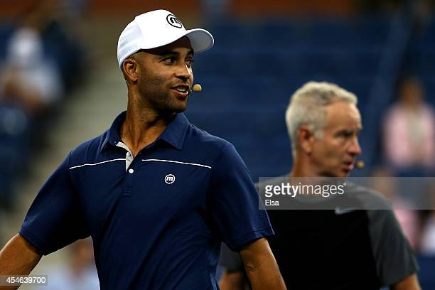James Blake and John McEnroe of the United States looks on against Jim Courier of the United States and Mats Wilander of Sweden during their...