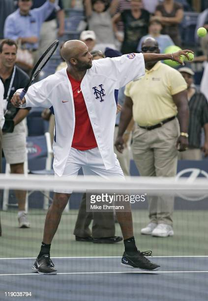 James Blake hits balls into the crowd while wearing a Carlos Beltran New York Mets jersey during his fourth round match against Tomas Berdych at the...