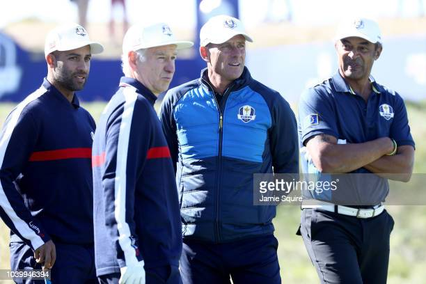 James Blake of Team USA John McEnroe of Team USA Guy Forget of Team Europe and Yannick Noah of Team Europe looks on during the celebrity challenge...