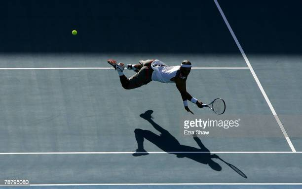 James Blake of the United States dives for the ball during his matach against Fabrice Santoro of France during day two of the Medibank International...